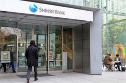 Japan's banking minnows swim in risky waters