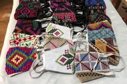 Egyptian women bring Bedouin embroidery to virus fight