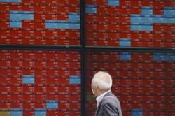 Tokyo shares lose steam but near 3-month high on rebound hopes, weaker yen