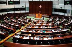 Hong Kong legislature passes national anthem bill amid protests
