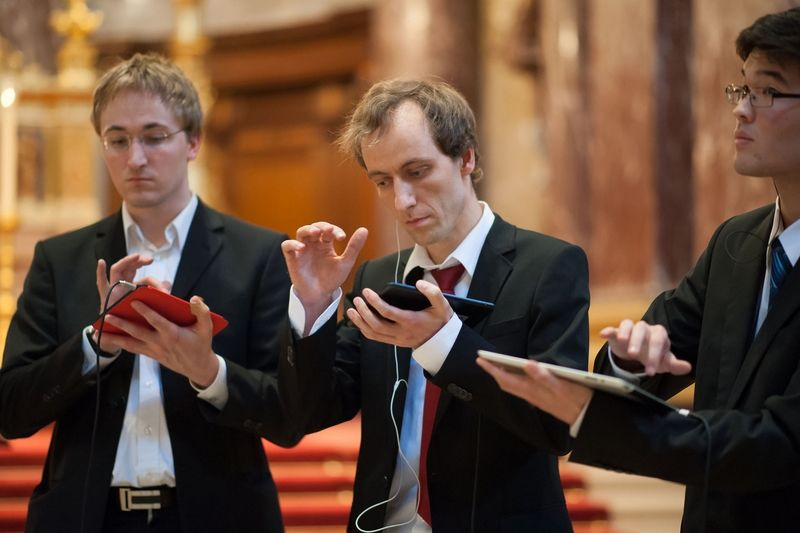 A tablet trio with Matthias Krebs (centre) plays a Bach concert in Berlin Cathedral using apps as instruments. — Sven Ratzel/dpa