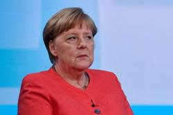 Germany's Merkel calls for reconciliation after
