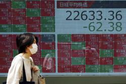 Asian markets fluctuate as dealers take breather ahead of US jobs data