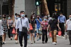 Singapore reports 261 new coronavirus cases, smallest rise in two months
