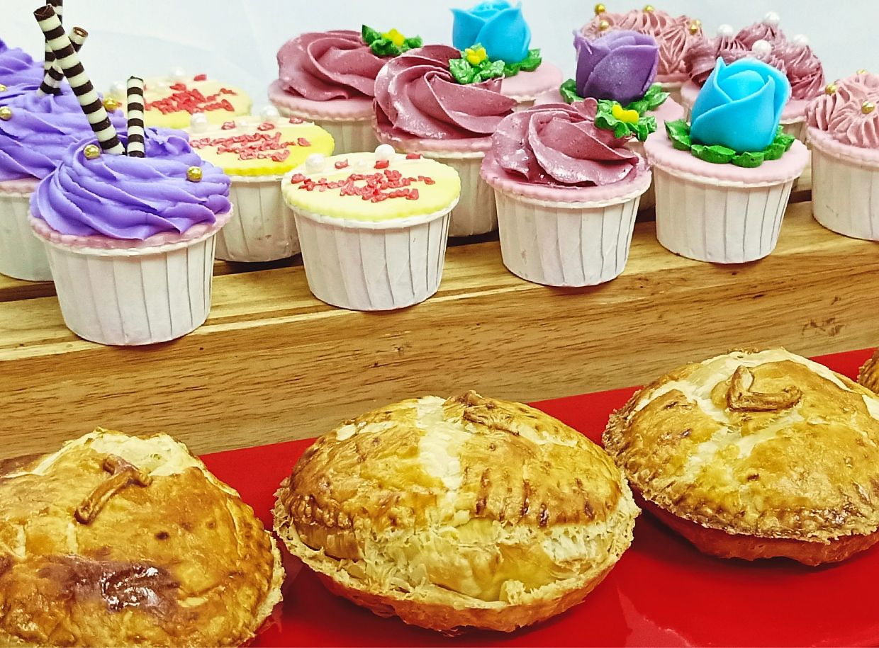 The Little Delights section offers cupcakes (top) and beef, chicken or salmon pies.