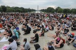 Electric skateboard-mounted trash collector among U.S. protest volunteers