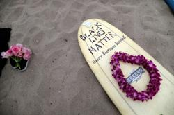 Black girls and supporters surf around the world to honor George Floyd