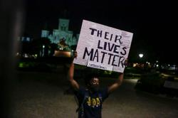 U.S. officials block police 'extreme tactics' as protests enter 12th day