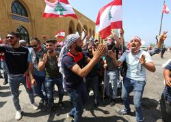 Hundreds of Lebanese resume anti-government protests as lockdown eased
