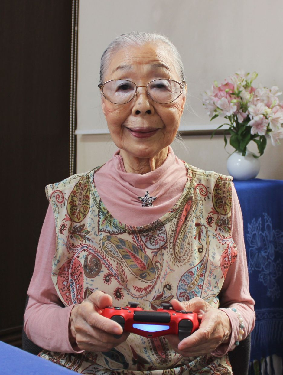 Mori, dubbed Japan's 'Gamer Grandma', posing with her video game controller in Matsudo, Chiba prefecture. — Keisuke Nagao/AFP/Handout