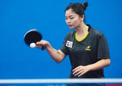 Ho Yin is top gun in singles, but she's back-pedalling