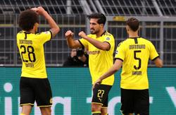 Dortmund beat Hertha to maintain faint title hopes