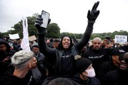 World champion Joshua attends march, says racism is a pandemic