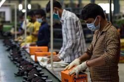 Migrant worker virus exodus plunges India's factories into crisis