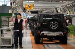 China's passenger car sales expand amid stronger demand