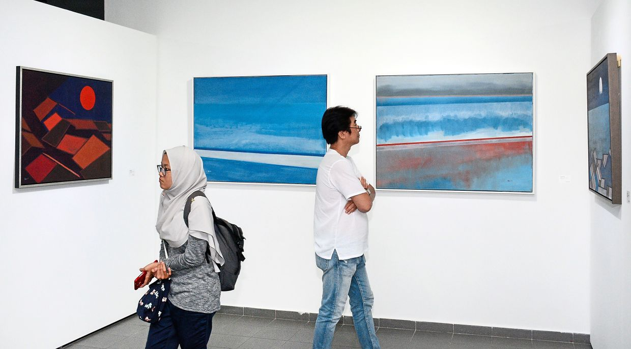 Guests admiring artworks at an exhibition held at the Penang State Art Gallery a few years ago. — Filepic