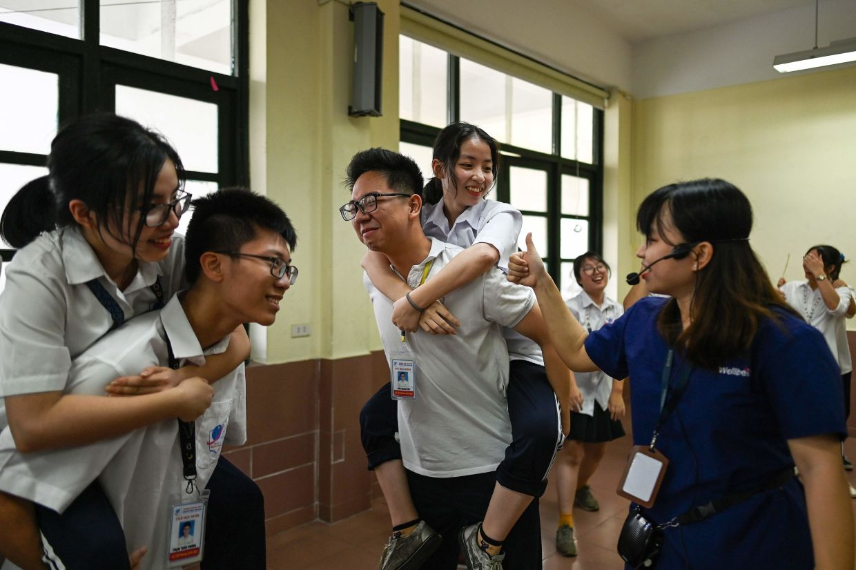 Sex-education counsellor Trinh Huong Ly (R) interacting with high school students during a
