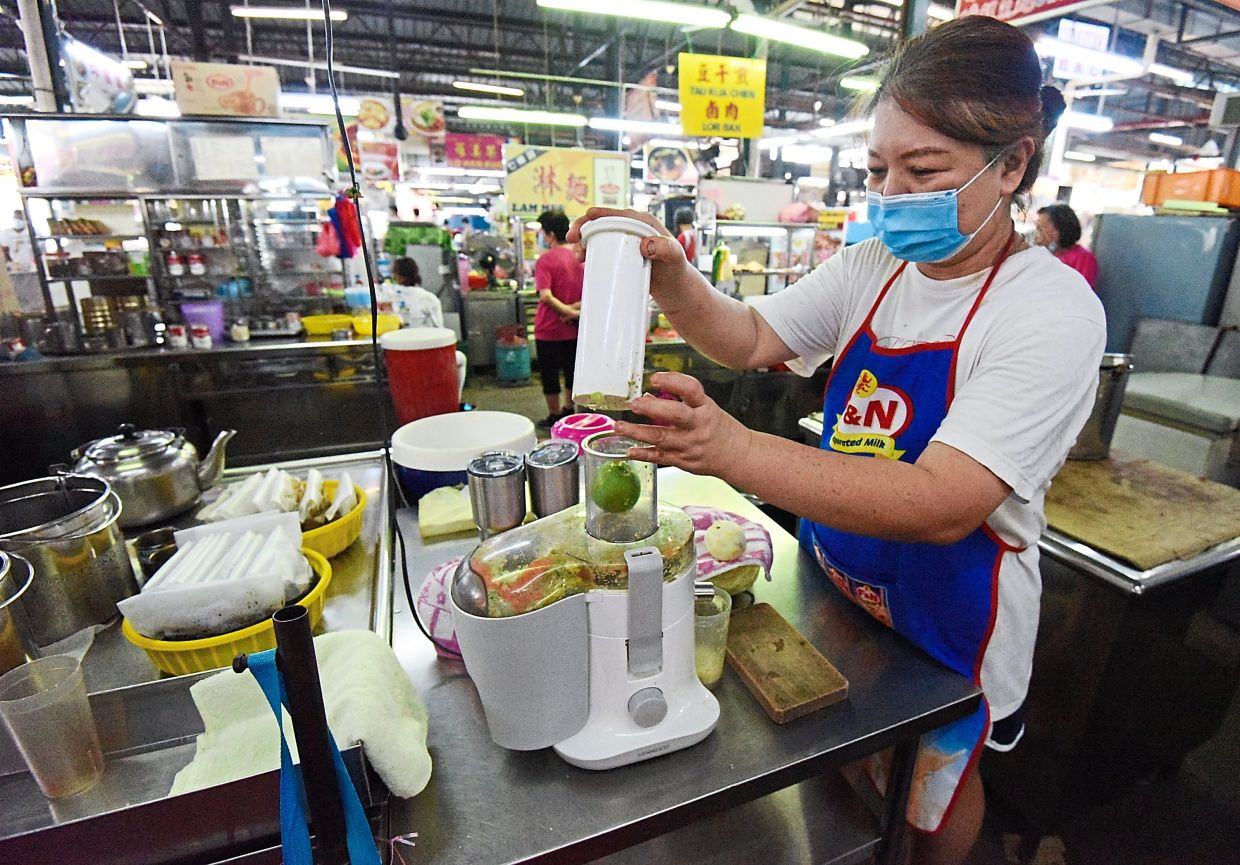 Lim says the prices of drinks and juices at her stall remain the same.