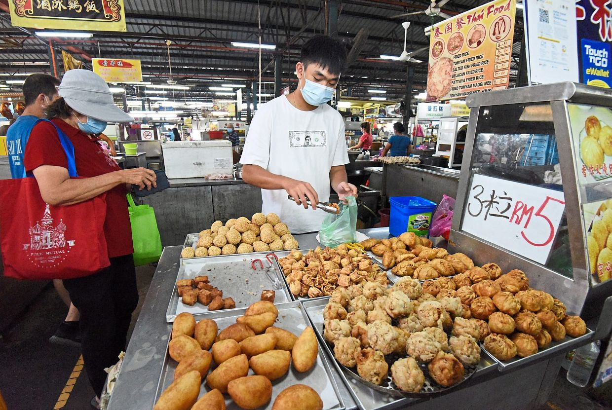 Ooi says there is no price increase for his fried snacks so as not to burden customers during the pandemic.