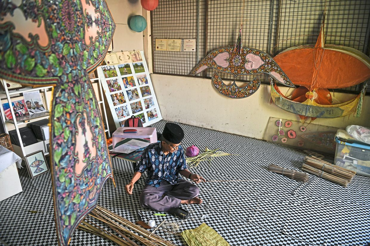 Pak Non says he picked up the art of making wau daun palas (palas leaf kite) in the 1970s from his grandfather. Photo: Bernama