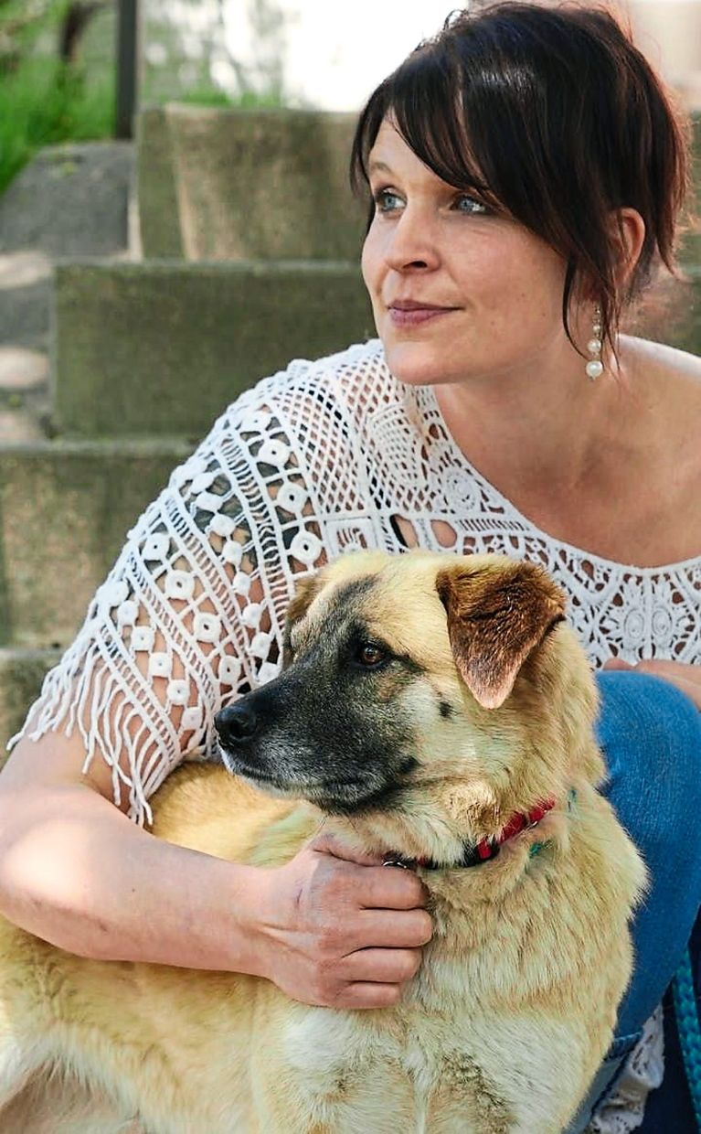 Seneca Krueger spent more than three months looking for Zelda, and was reunited after the dog was trapped by a rescue group. She has since adopted Zelda. — TNS