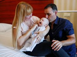 After long delay, parents finally meet surrogate baby in Ukraine