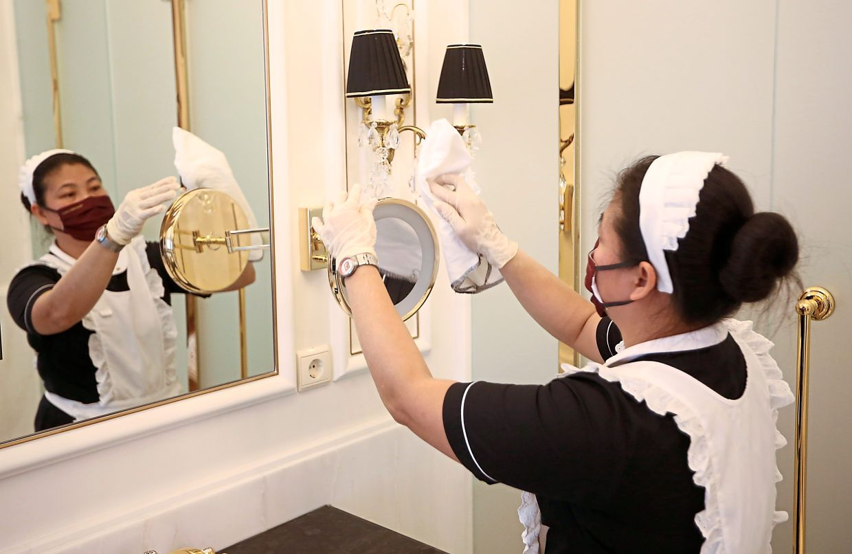 A housekeeping staff cleaning a room in a luxury hotel in Vienna, Austria. Guests need to see and be assured that hotels take all measures of safety and hygiene seriously. — Reuters