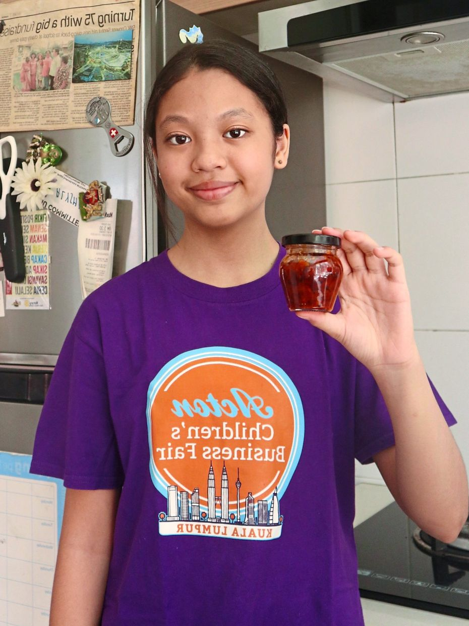 Inspired by her mum whom she learnt to cook from, Aqeesha has made two types of sambal to sell at the fair. Photo: Aqeesha Lara Yusoff