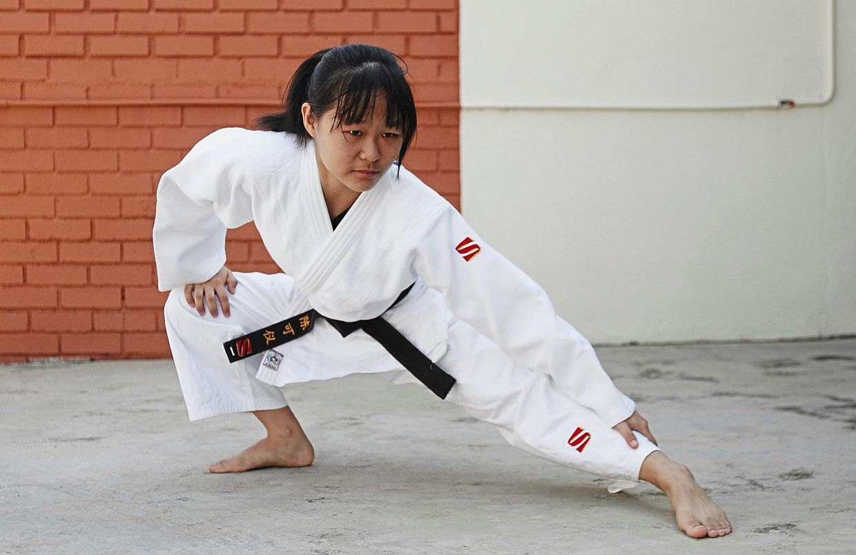 Tan performing her training exercises at her home in Pulau Tikus, Penang. — Photos: ZHAFARAN NASIB/The Star