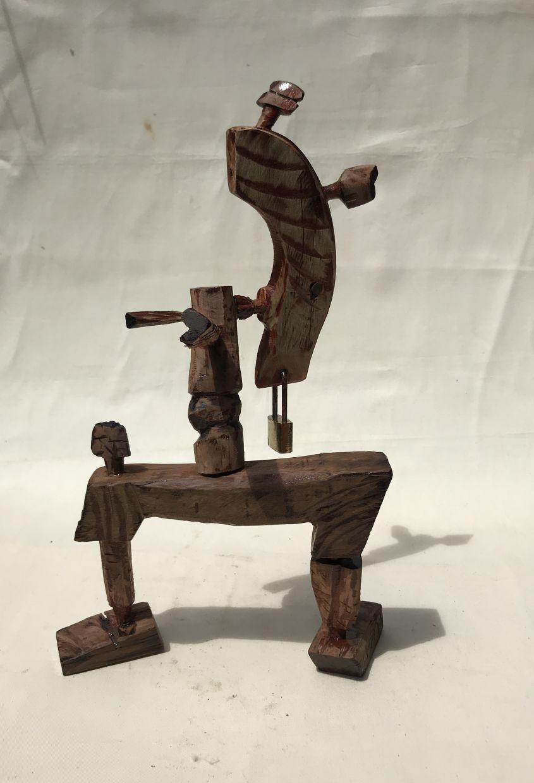 'Corona #Lockdown 1' (wood sculpture, 2020).