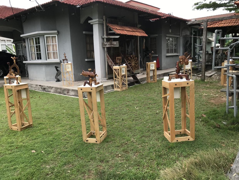 No gallery, no problem: Rosli's 'Corona Series' sculptures on temporary display at his Tukang Arca home studio in Melaka.