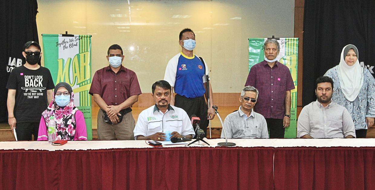 (Seated from left) Normah, Thomas, Muhammad Faizul and massage therapist Rajeevan Gopala Krishnan with MAB members at the press conference in Brickfields.