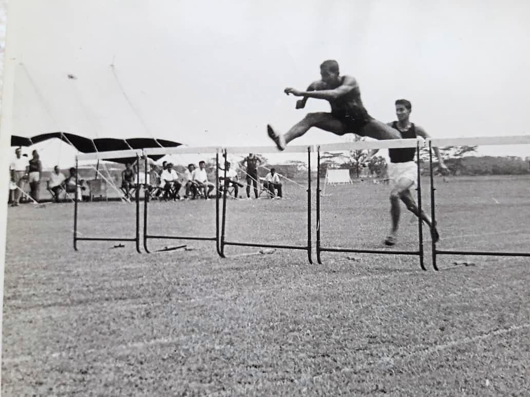 Karu running hurdles in the 1960s.