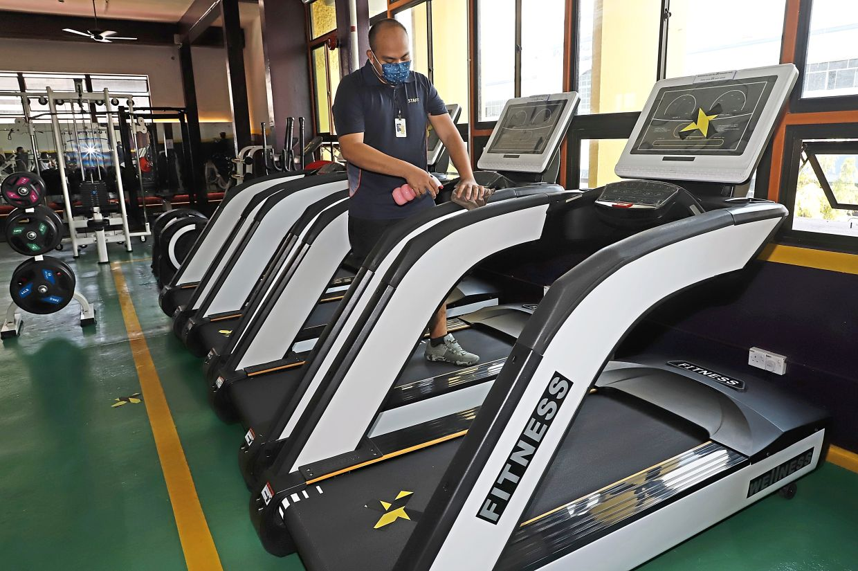 Too disinfecting a treadmill at the gym in Penang Road.