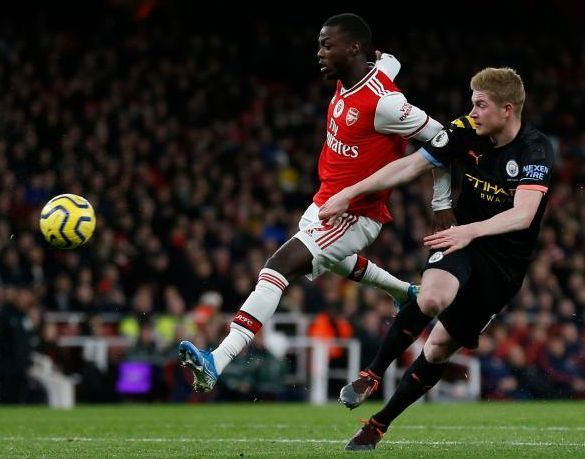 Arsenal's Nicolas Pepe (left) vying with Manchester City's Kevin De Bruyne during their EPL match at the Emirates Stadium in London on Dec 15, 2019. The two teams meet again when EPL resumes, with the match shown live on Astro SuperSport on June 18, 3.15am