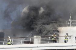 Black smoke billowing from cruise ship docked near Tokyo