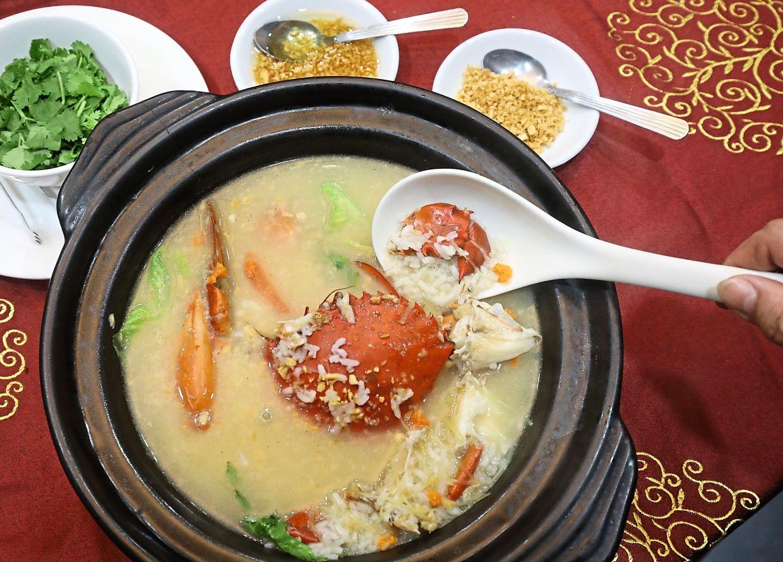 Teochew-style Yellow Oil Crab Porridge.