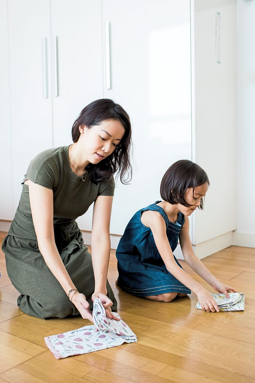 The KonMari method is something that the whole family can do. Jo-Rushdy demonstrates to her child how to fold properly. Photo: Spark Joy & Flow