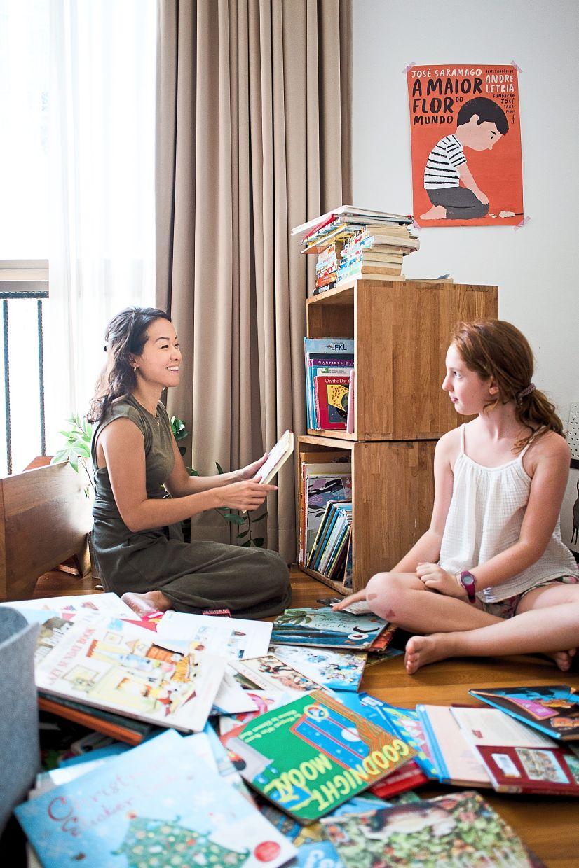 Jo-Rushdy (left) in action, tidying a bookshelf. Photo: Spark Joy & Flow