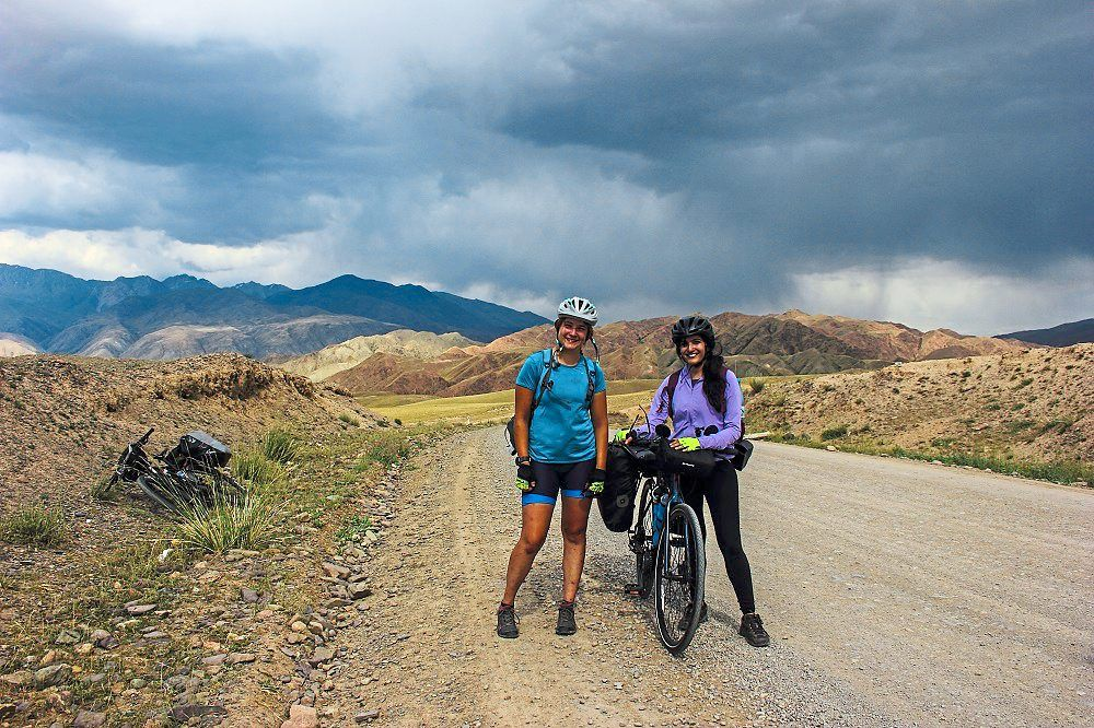 The writer (right) and her new-found friend Joanna cycled along the Silk Road in Kyrgyzstan.