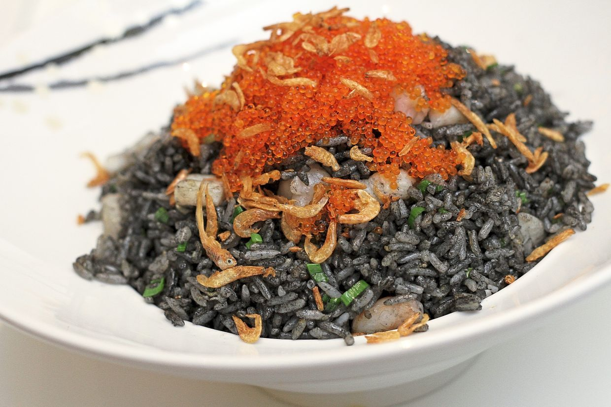 Refined Dried Shrimp Fried Rice with Seafood and Sepia Ink offers a distinct briny flavour.