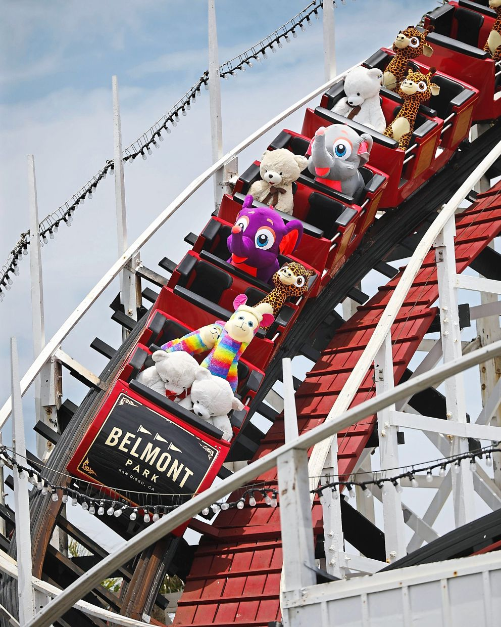 Stuffed toys ride the Giant Dipper rollercoaster at Belmont Park on June 1. The park has been running the coaster to keep it from tightening up during the recent closures. — K.C. ALFRED/TNS