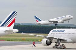 France warns carrier against forced job cuts