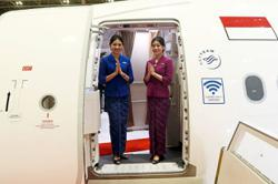 Garuda to drop masks for service with a smile