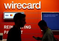 Wirecard slumps 40% as search for missing billions turns to Philippines