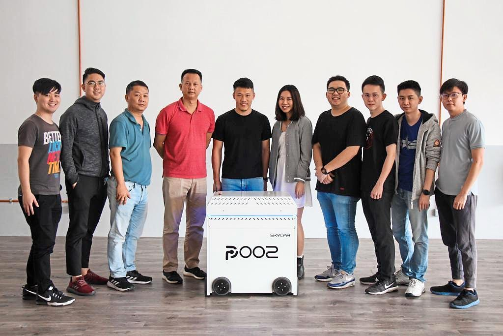 Good sales: Chuah (fifth from left), seen here with his team, expects revenue to range about RM15mil to RM20mil next year.