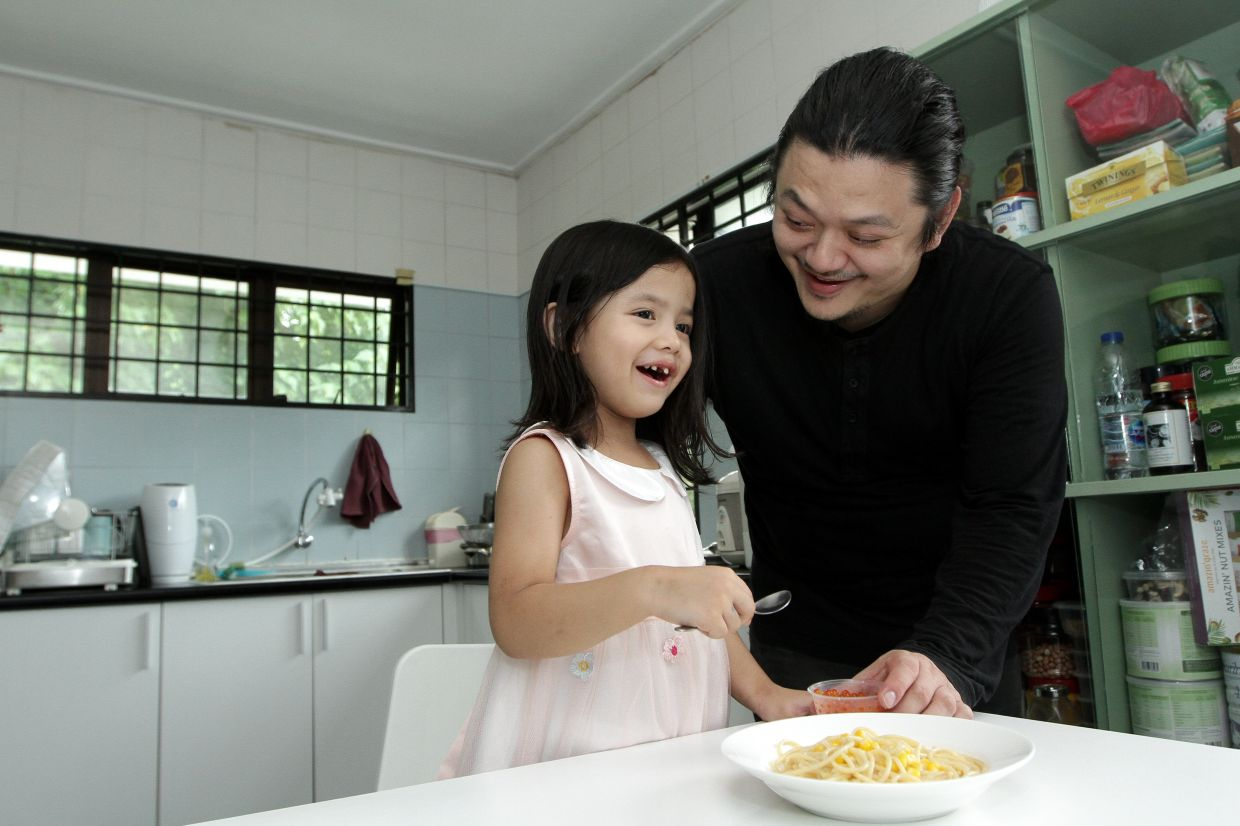 Chai says he has had to figure out what he can cook for Elise through a lot of trial and error, as she is a bit of a picky eater. — YAP CHEE HONG/The Star