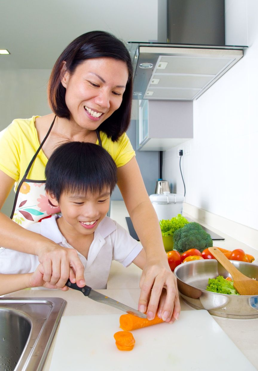 Mothers traditionally assume a larger share of unpaid housework on top of their paid work. Photo: 123rf.com