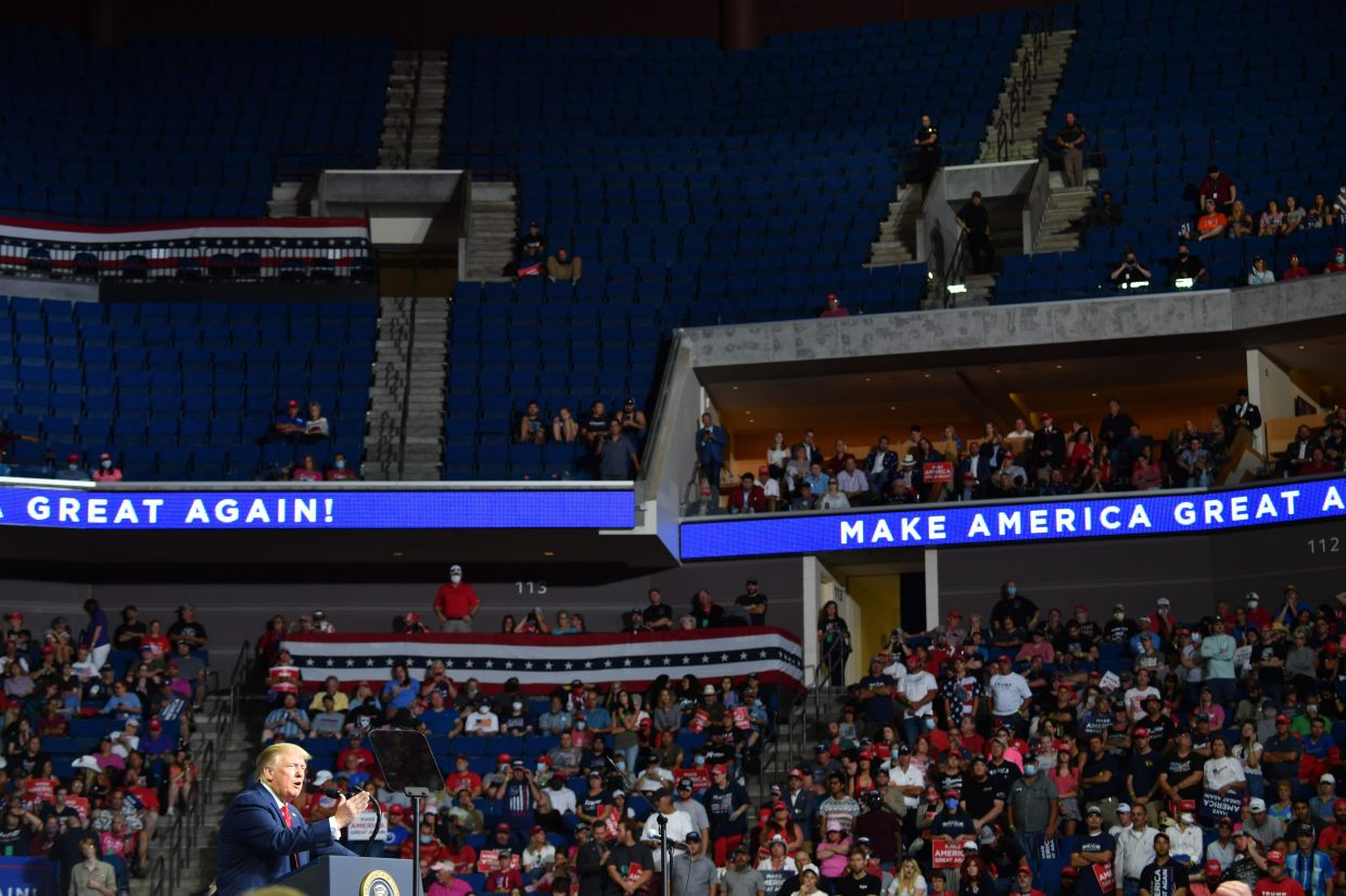 In this file photo the upper section of the arena is seen partially empty as US President Donald Trump speaks during a campaign rally at the BOK Center on June 20,2020 in Tulsa, Oklahoma. Photo: AFP