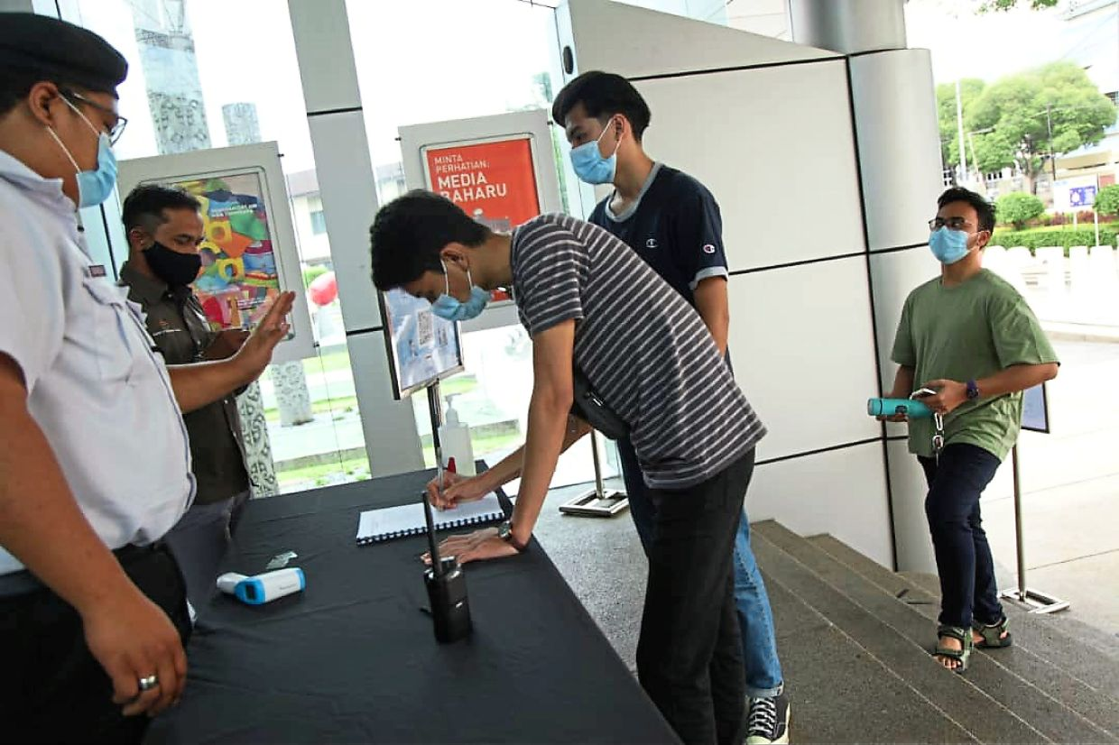 Visitors being checked by National Art Gallery staff before they entering the building in Kuala Lumpur on June 23. Photo:  National Art Gallery